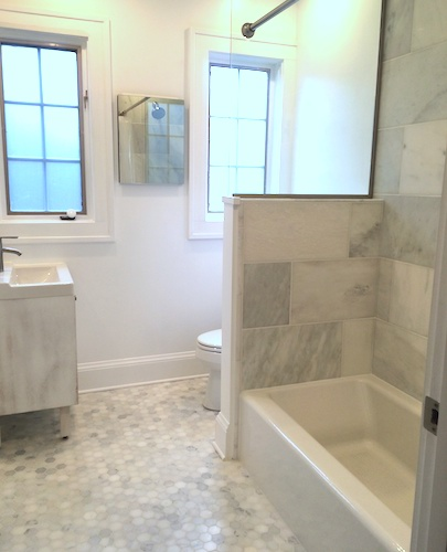 After: minimalist bathroom with lots of space